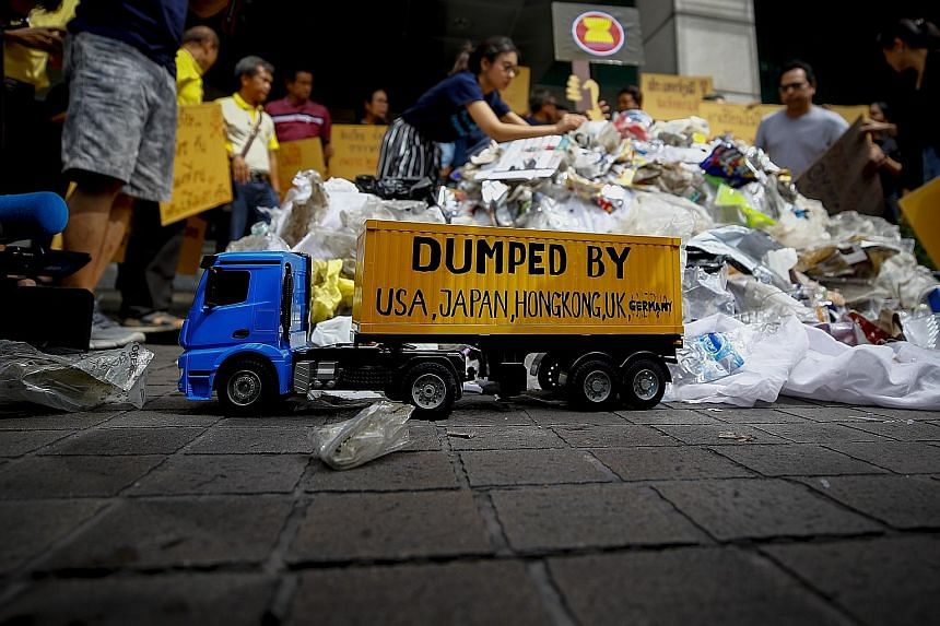 Greenpeace activists in Thailand staging a protest in front of the Ministry of Foreign Affairs in Bangkok, where they dumped plastic waste and held placards calling for an end to all trash imports to South-east Asia. After China's decision last year