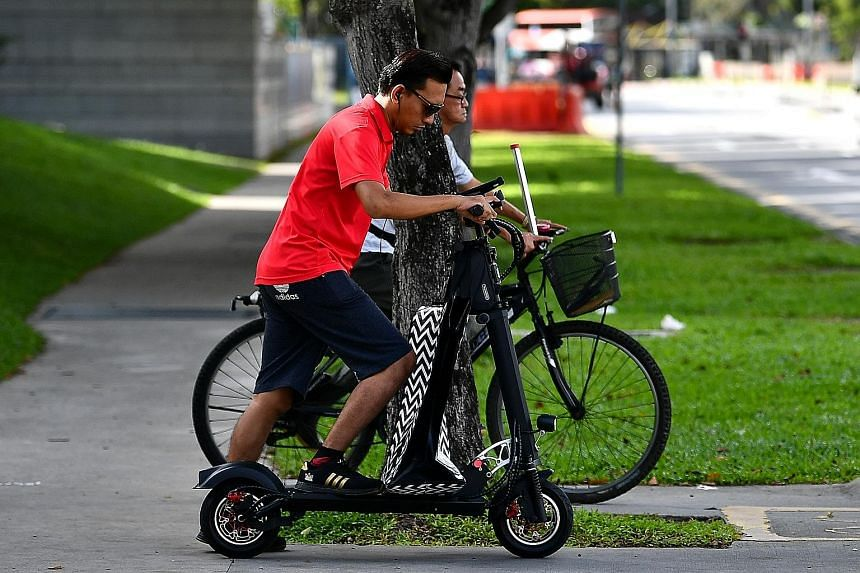 From July, it will be illegal for PMD users to ride, or cause or allow another person to ride, an unregistered e-scooter on public paths. ST PHOTO: LIM YAOHUI