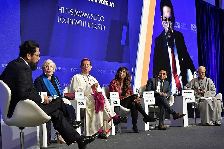 From left: Dr Farish A. Noor, associate professor of the S. Rajaratnam School of International Studies; author Karen Armstrong; Spanish Bishop Miguel Angel Ayuso Guixot, president of the Pontifical Council for Inter-religious Dialogue at the Vatican;