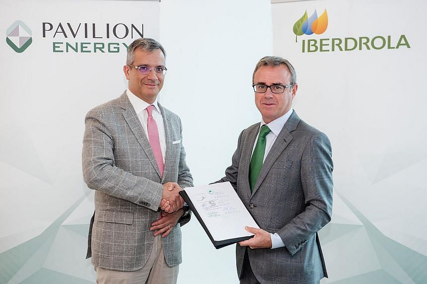 Pavilion Energy group chief executive Frederic Barnaud (far left) and Mr Aitor Moso, chief executive of liberalised business at Iberdrola, after signing the deal. PHOTO: PAVILION ENERGY