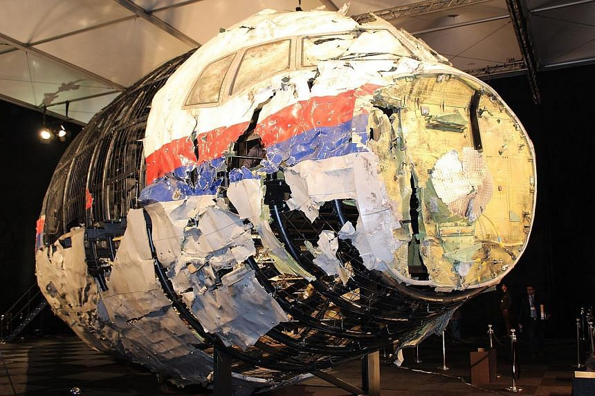 The reconstructed front part of the Malaysia Airlines plane at the Gilze-Rijen Air Force Base, in the Netherlands, in 2015. Parts of the cockpit and business class section were reconstructed from wreckage retrieved from Ukraine and taken to the Nethe