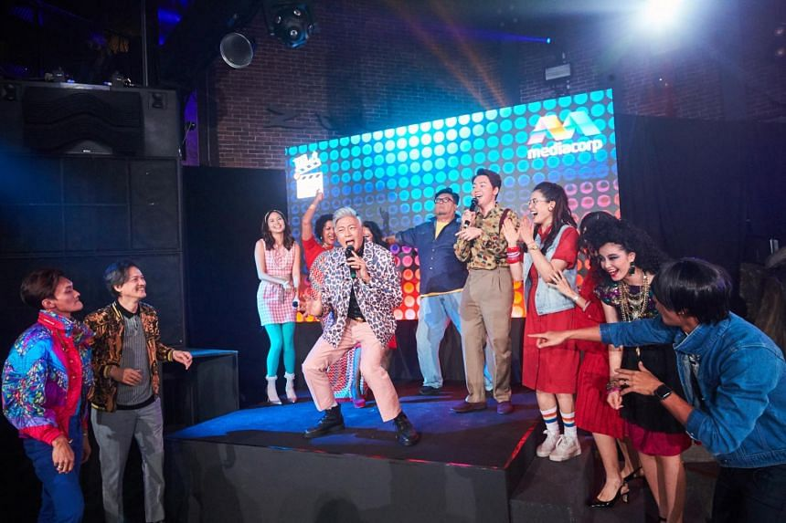 Dick Lee singing his iconic song Fried Rice Paradise with the cast of its drama series adaptation.