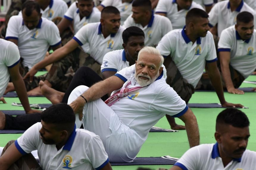 Indian Prime Minister Narendra Modi performs yoga at a mass yoga event on International Yoga Day in Ranchi in eastern Jharkhand state, on June 21, 2019.