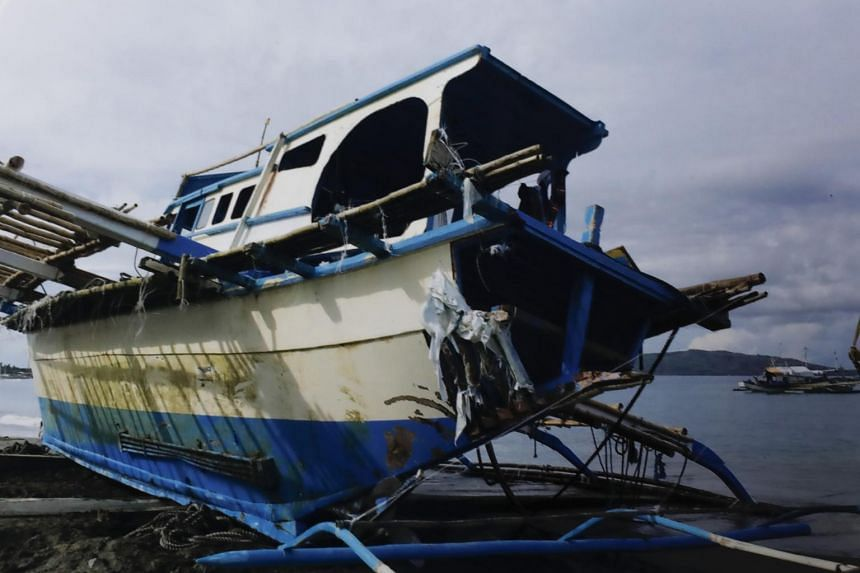 The damaged Philippine fishing vessel at the shore of San Jose town, Occidental Mindoro province, Philippines.