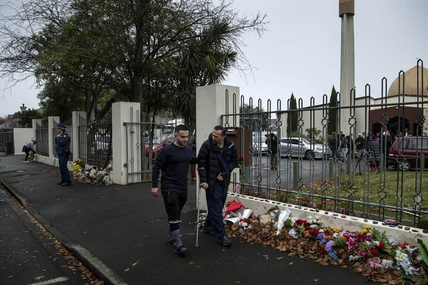 Temel Atacocugu (right) outside Al Noor mosque in Christchurch, New Zealand, where he was shot nine times in March.