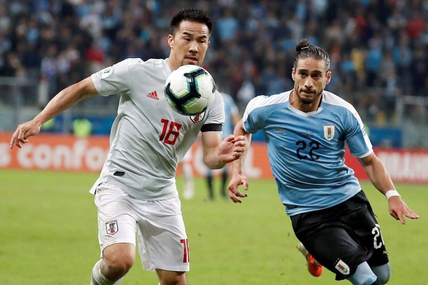 Martin Caceres (right) of Uruguay in action against Shinji Okazaki of Japan during the Copa America 2019 Group C soccer match between Uruguay and Japan, at Arena do Gremio Stadium in Porto Alegre, Brazil, on June 20, 2019.