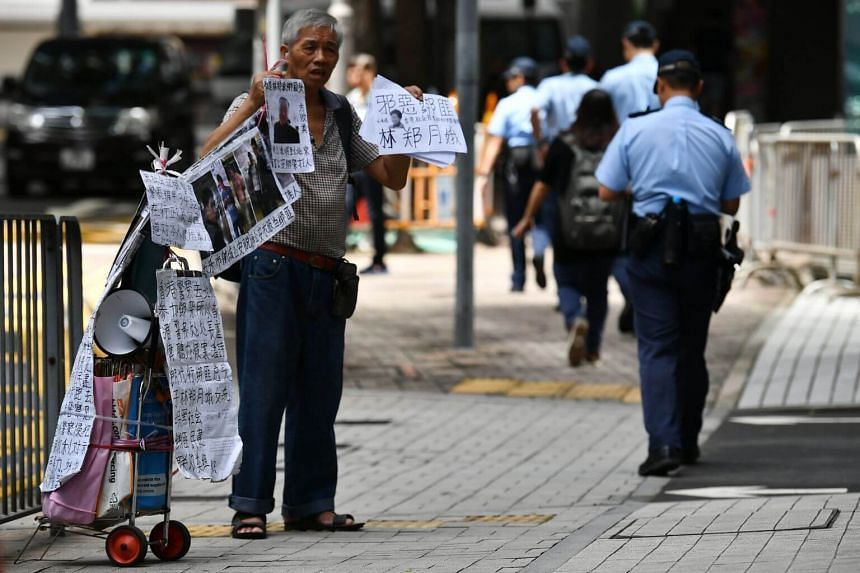 A protester outside the Hong Kong Police Headquarters at Arsenal Street on June 20, 2019.