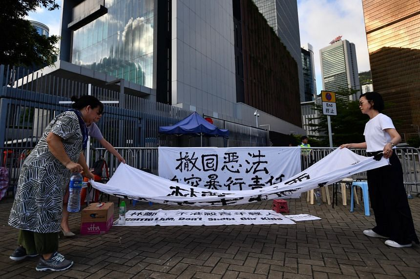 A few protesters set up a protest banner outside the Chief Executive's Office building on June 21, 2019.
