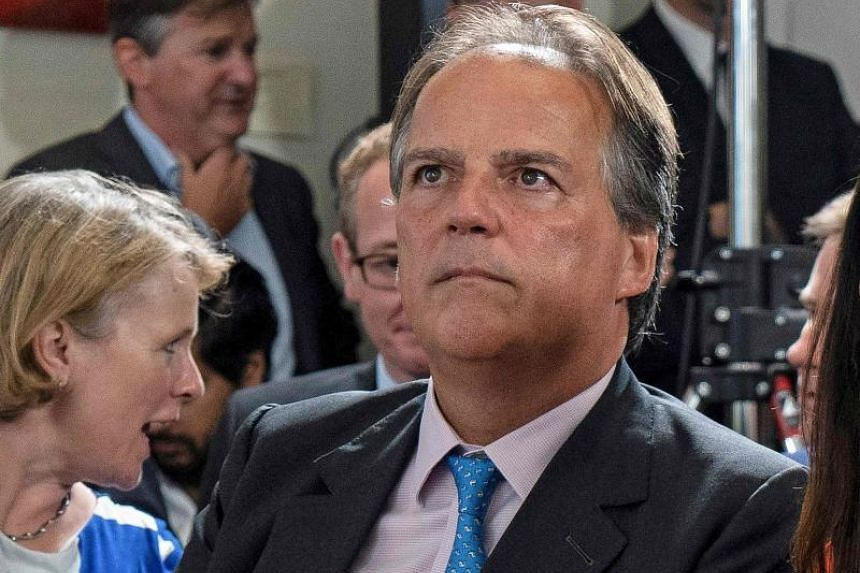 A video posted by ITV showed British Foreign Office Minister Mark Field appearing to push a protester against a wall and grab her by the neck and forcing her out of the hall.