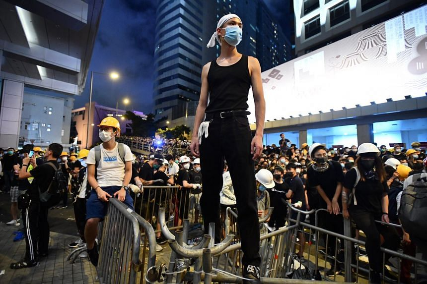 Protesters outside Hong Kong's police headquarters in the evening on June 21, 2019.