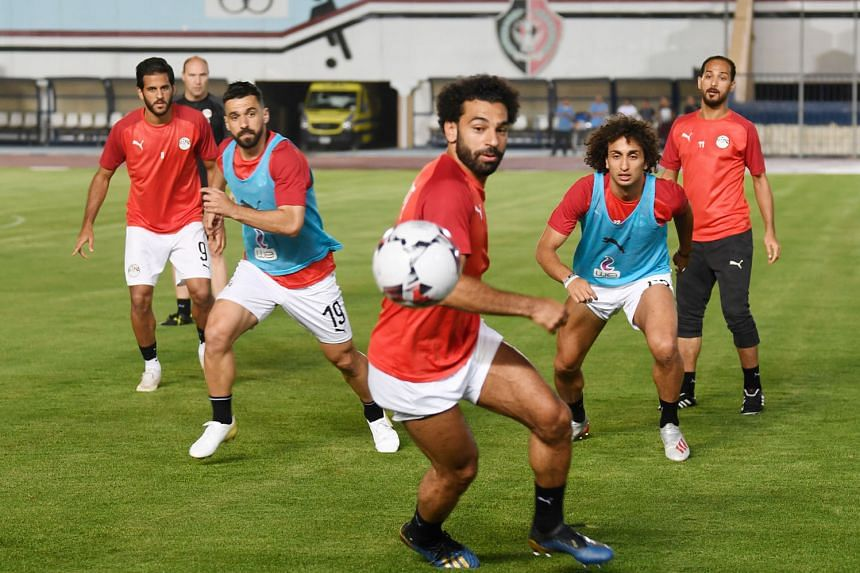 Egypt's star forward Mohamed Salah on the ball during training last Sunday at the Cairo Military Academy Stadium, with teammates including defender Abdullah al-Saeed (second from left) and midfielder Amr Warda (second from right). The hosts play Zimb