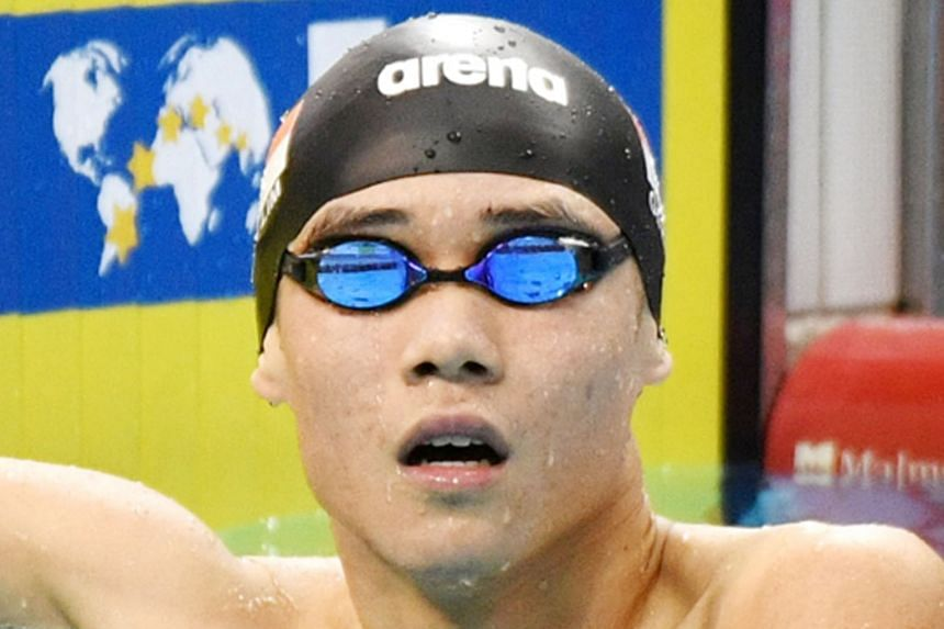 Above: Glen Lim after finishing fourth in the 200m freestyle at the Singapore National Swimming Championships last night. He is one of the contenders for a spot in Singapore's 4x200m free team at the World Championships in South Korea next month. Lef