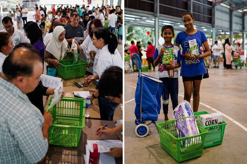 Siblings Jayben and Sabrina Louis (both above) with items from a pop-up supermarket in Yishun. They were among the beneficiaries from low-income households given vouchers to shop at two pop-up supermarkets for what they needed or wanted (left). ST PH