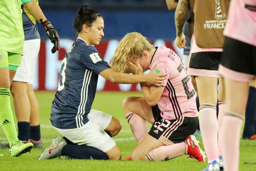 Argentina's Eliana Stabile consoling Scotland's Erin Cuthbert after the South Americans snatched a 3-3 draw thanks to a controversial stoppage-time penalty at the Parc des Princes. The result eliminated the Scots.