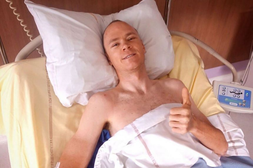 Froome gestures from his hospital bed in a photo posted to his Twitter account.