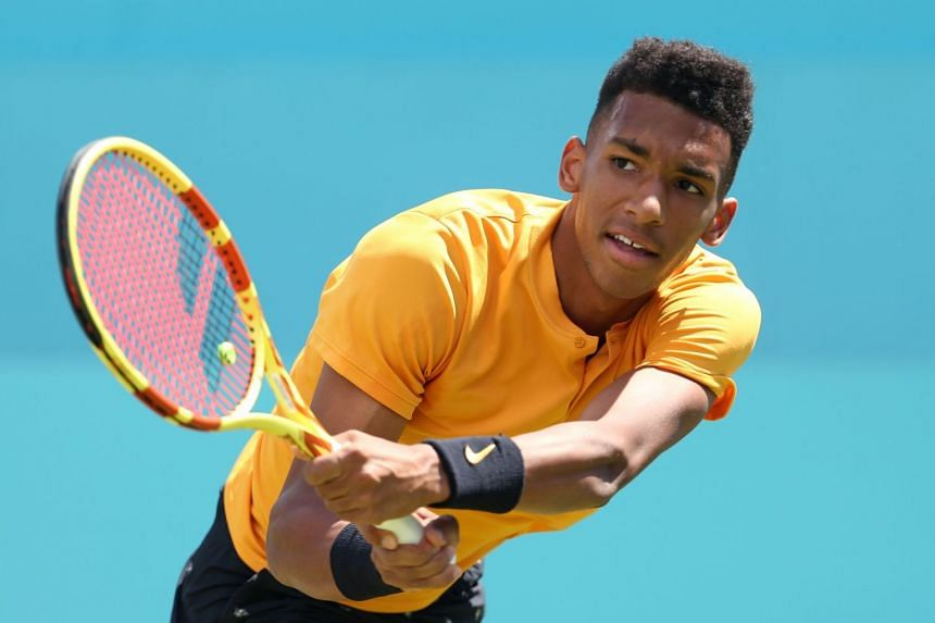Auger Aliassime in action against Greece's Stefanos Tsitsipas.