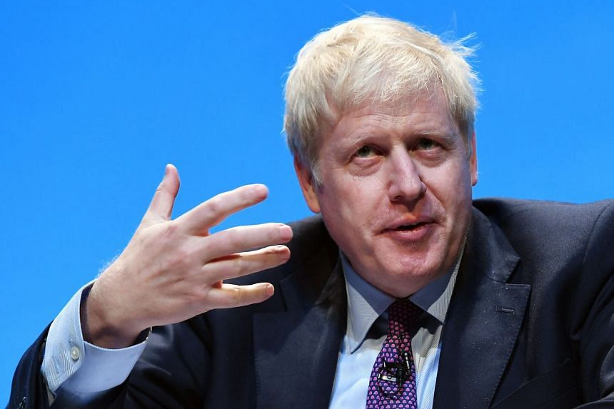 Johnson speaks to Conservative Party members in Birmingham, Britain.
