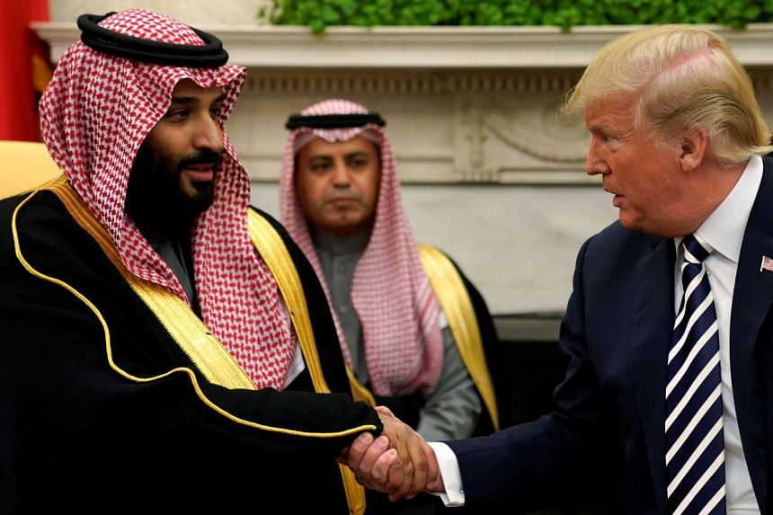 Trump shaking hands with the Crown Prince at the White House in March 2018.