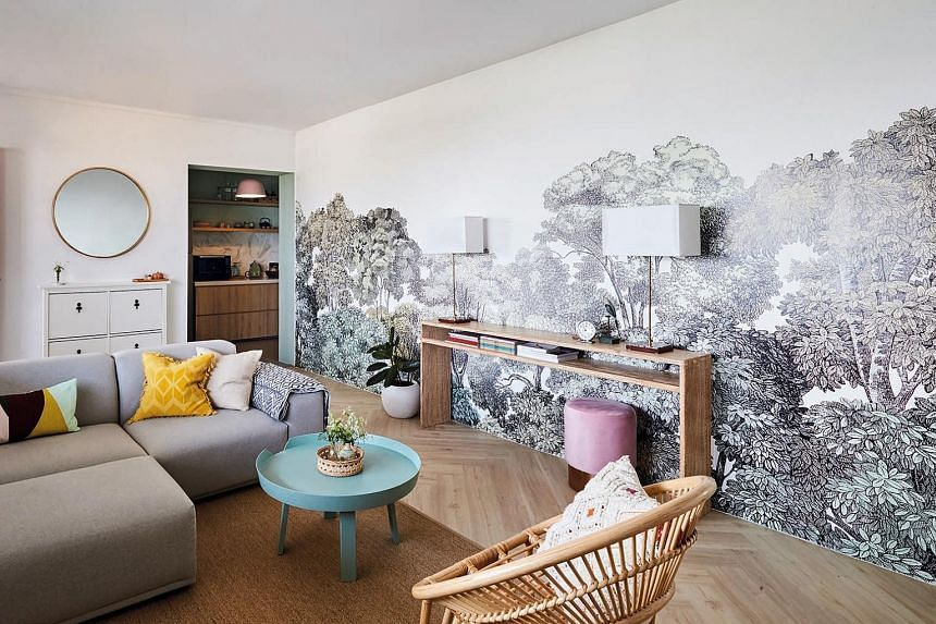 Wood-look vinyl, which is arranged in a herringbone pattern, adds to the flat's tropical vibe.