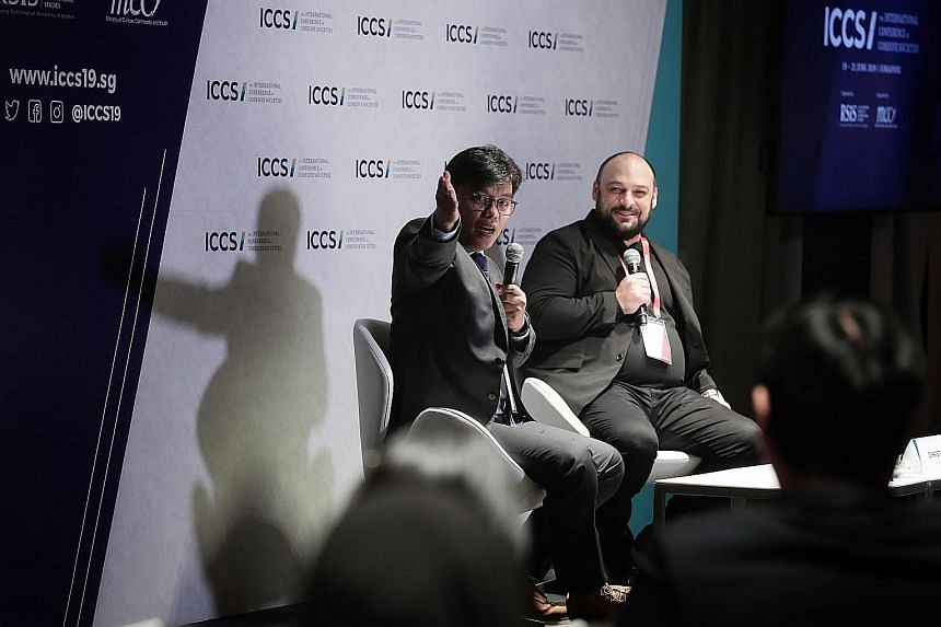 Indonesian activist Noor Huda Ismail (far left) and former white supremacist recruiter Christian Picciolini at a session on overcoming hate at the International Conference on Cohesive Societies yesterday. ST PHOTO: KELVIN CHNG