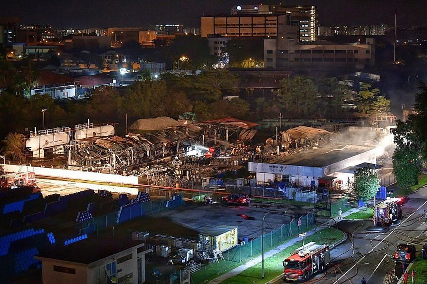 The SCDF was alerted to the blaze at 43 Jalan Buroh just after 5pm, and about 120 firefighters were deployed to control the fire, which had spread rapidly across the facility about the size of two football fields, triggering loud explosions. PHOTOS: