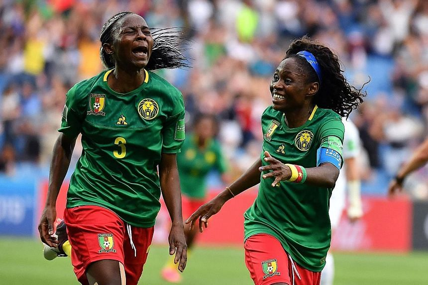 Cameroon's Ajara Nchout (far left) celebrating her second goal in the last minute of added time against New Zealand with teammate Gabrielle Onguene. Cameroon won the World Cup group match 2-1 in Montpellier.