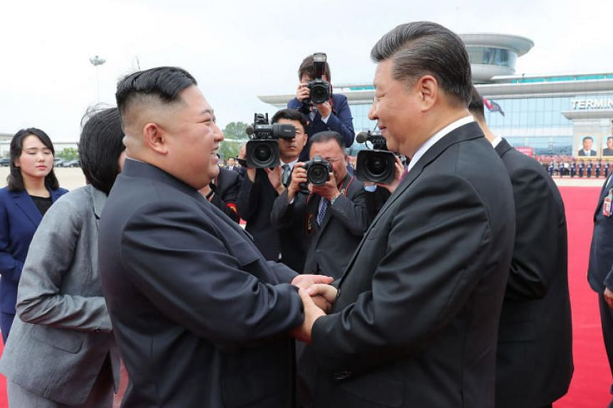 Chinese President Xi Jinping with North Korean leader Kim Jong Un at the airport in Pyongyang for Mr Xi's departure on June 21, 2019.