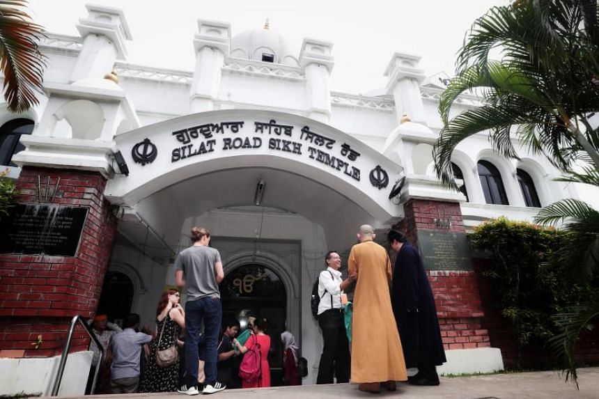 """At the Silat Road Sikh Temple, participants attended a """"crash course"""" on the Sikh religion and cultural norms."""