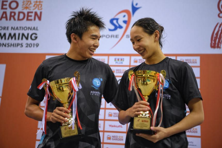 Jonathan Tan and Cherlyn Yeoh with their trophies on the final day of the Neo Garden 15th Singapore National Swimming Championships on June 22, 2019.