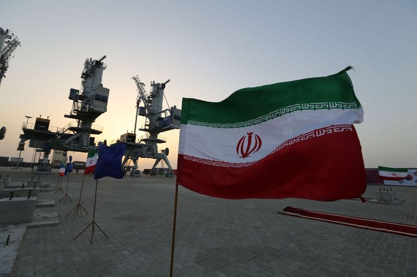 Iranian flags flutter during an inauguration ceremony for Shahid Beheshti Port in the southeastern Iranian coastal city of Chabahar.