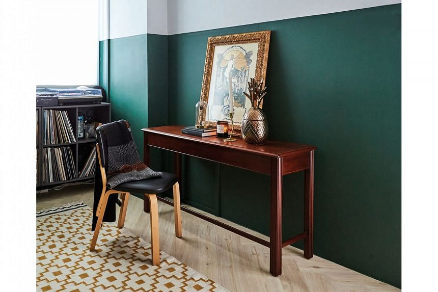 The library-like space sports a darker olive shade, distinct from the rest of the flat.