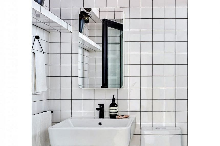The bathroom is in sync with the master bedroom's white theme.
