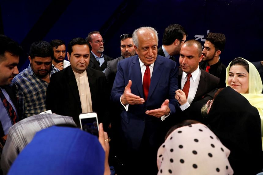 Zalmay Khalilzad talks with Afghans after a TV debate in Kabul, April 28, 2019.