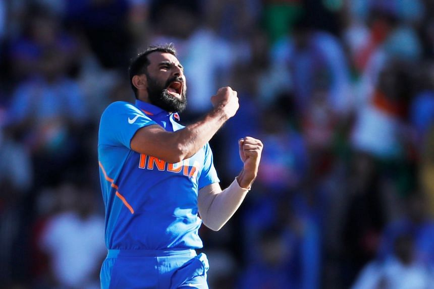 India's Mohammed Shami celebrates taking the wicket of Afghanistan's Aftab Alam.