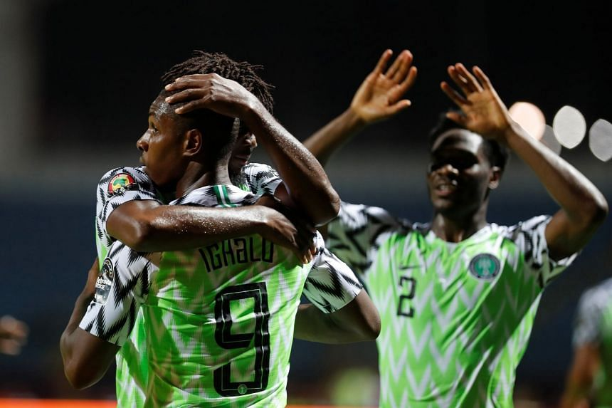 Nigeria's Odion Ighalo and team mates celebrate scoring their first goal.