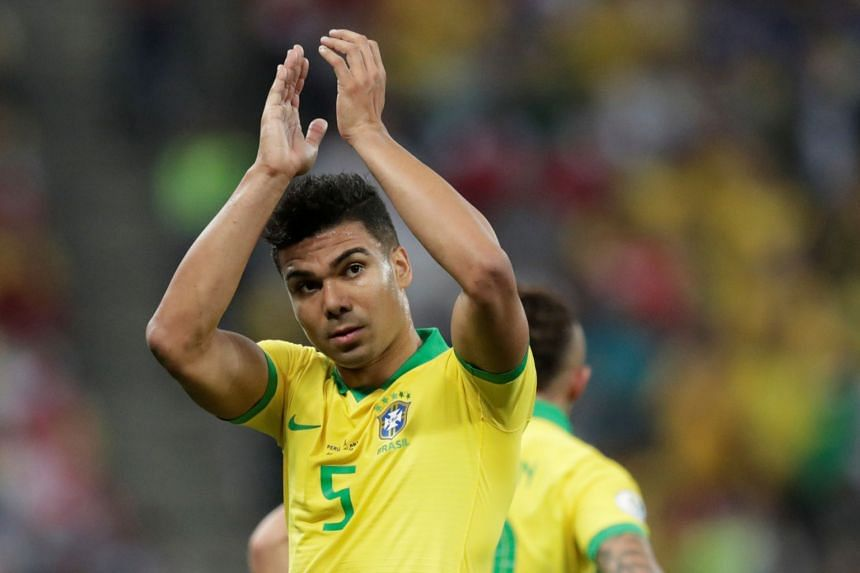 Brazil's Casemiro applauds fans after he is substituted.