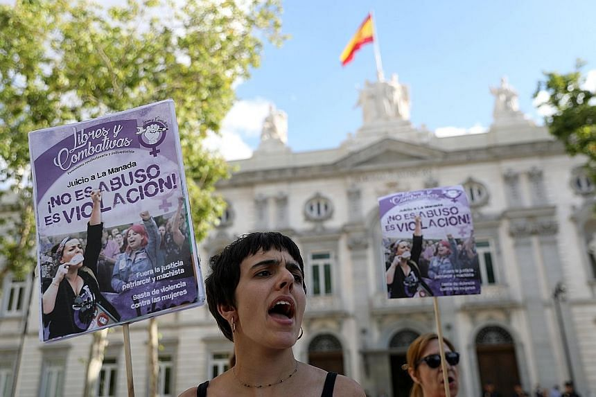 "Protesters outside Spain's Supreme Court in Madrid with banners that read ""It's not abuse, it's rape"", on Friday. Outrage over an earlier lower court verdict in a rape case helped put the treatment of women at the heart of public debate in Spain, inc"