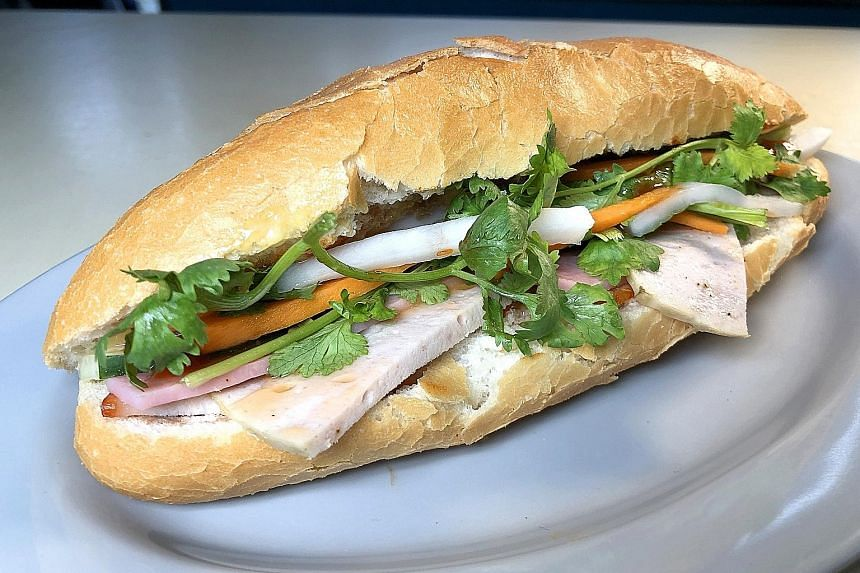 Kim Phung's Banh Mi consists of a freshly baked Vietnamese-style baguette filled with radish and carrot pickles, braised pork belly and pork liver pate.