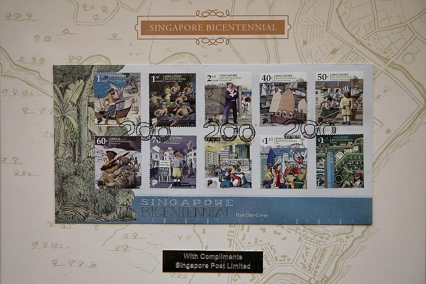 SingPost has launched 10 stamps depicting key milestones in Singapore's 700-year history, including the arrival of the British, independence and a vision of the future. ST PHOTO: KEVIN LIM