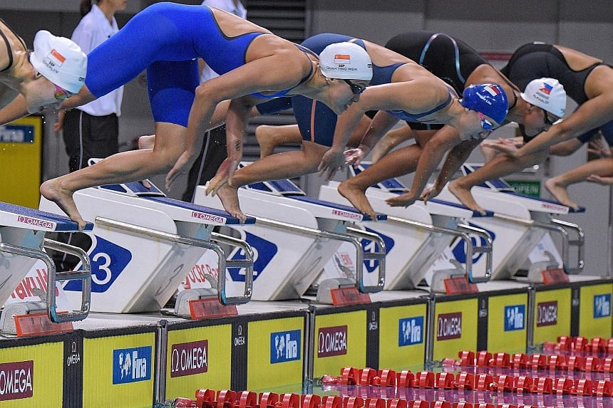 Quah Ting Wen (second from left) on the way to winning the women's 50m freestyle at the Neo Garden 15th Singapore National Swimming Championships. But she did not go under 25sec as she had hoped, managing only 25.26sec at the OCBC Aquatic Centre.