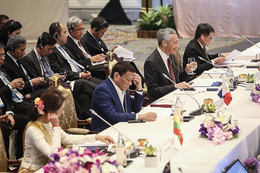 Prime Minister Lee Hsien Loong at the 34th Asean Summit Plenary Session in Bangkok yesterday. With him are (from left) Myanmar State Counsellor Aung San Suu Kyi, Philippine President Rodrigo Duterte and Asean Secretary-General Lim Jock Hoi. The Bangk