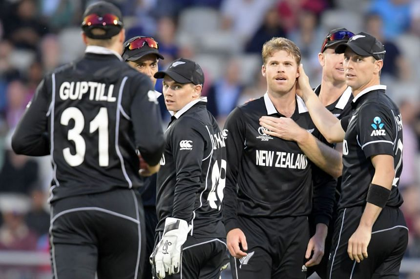 New Zealand's Lockie Ferguson (centre) celebrates with team mates after taking the wicket of West Indies' Sheldon Cottrell.