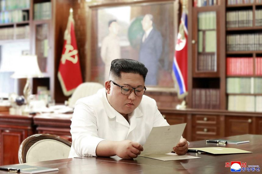 North Korean leader Kim Jong Un reads a personal letter from US President Donald Trump.