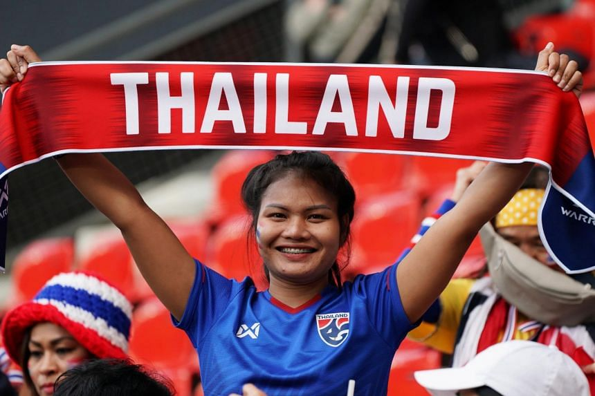 A supporter of Thailand cheers during the preliminary round match between Thailand and Chile at the FIFA Women's World Cup 2019 in France on June 20, 2019.