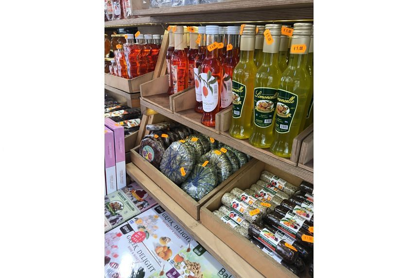 Local delicacies such as kumquat liquor, lemoncello and Corfiat fig pies for sale in Corfu Old Town.