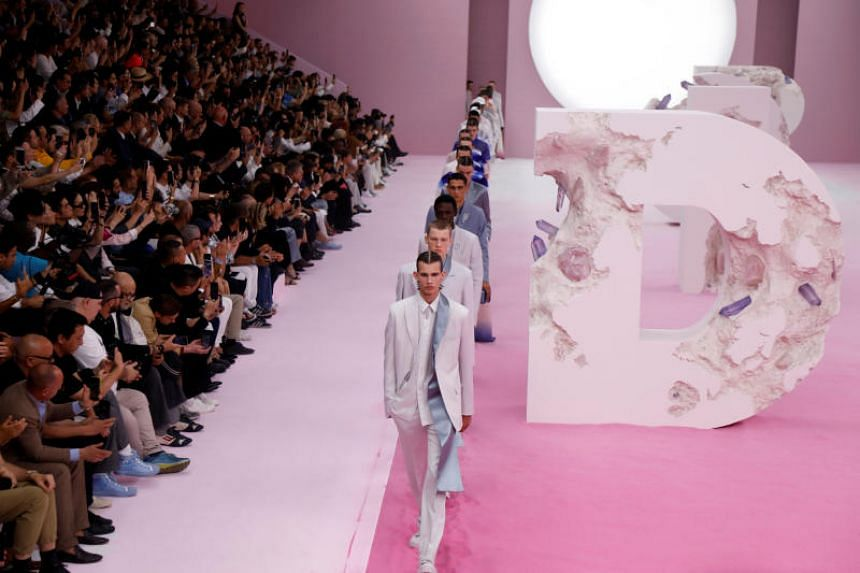 Models presenting creations by designers Kim Jones as part of his Spring/Summer 2020 collection show for Dior Homme, in Paris on June 21, 2019.