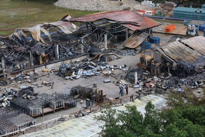 Debris is seen in the aftermath of a fire that broke out in Jalan Buroh, on June 22, 2019.