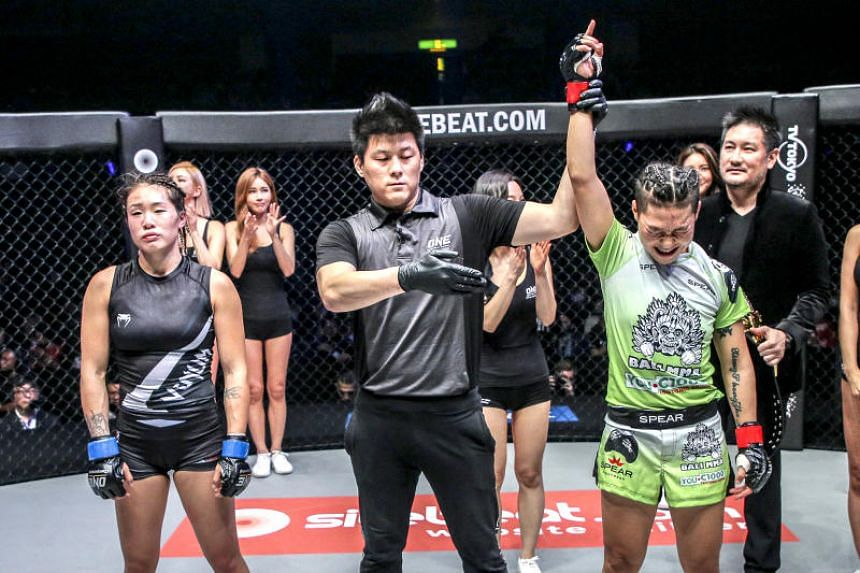 Angela Lee (left) reacting after her loss to Xiong Jingnan in their strawweight title at One Championship's A New Era event in Tokyo on March 31, 2019.