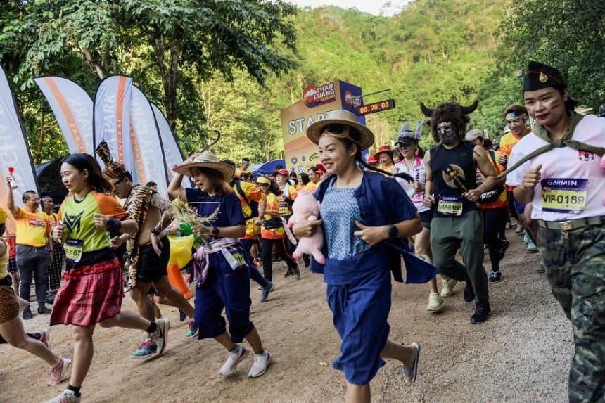 Participants running in a charity race near Tham Luang cave, on June 23, 2019.