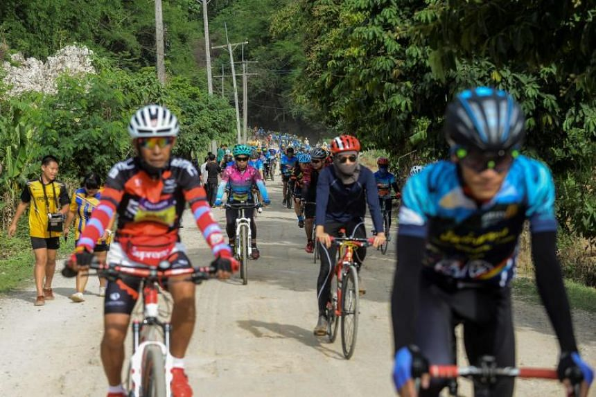 Bikers participating in a charity event commemorating the first anniversary of the day the Wild Boars youth football team entered Tham Luang cave, on June 23, 2019.
